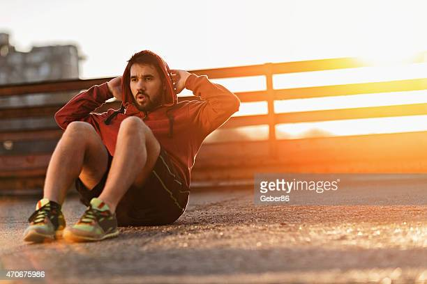 Photo of an athletic young man doing situps
