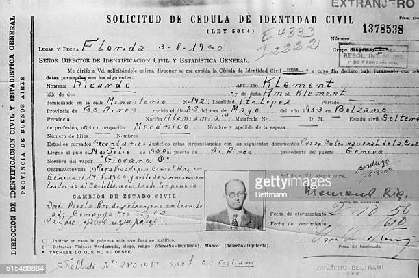 Photo of an identity card issued to Adolf Eichmann Nazi war criminal born in Solingen Germany He became a a member of the SS in 1932 and organizer of...