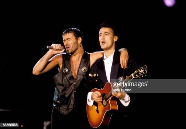 III Photo of Andrew RIDGELEY and George MICHAEL and WHAM Andrew Ridgeley appearing with George Michael at solo performance performing live onstage