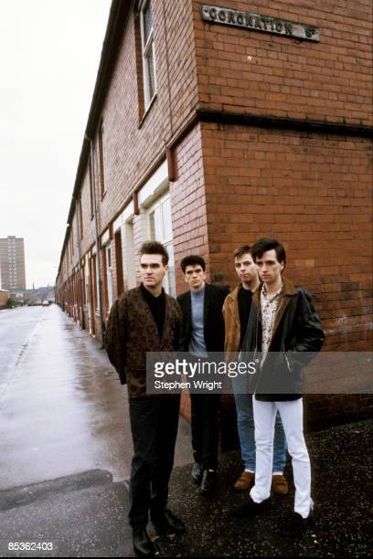 Photo of Andy ROURKE and Johnny MARR and Mike JOYCE and MORRISSEY and The Smiths LR Morrissey Mike Joyce Andy Rourke Johnny Marr posed group shot in...