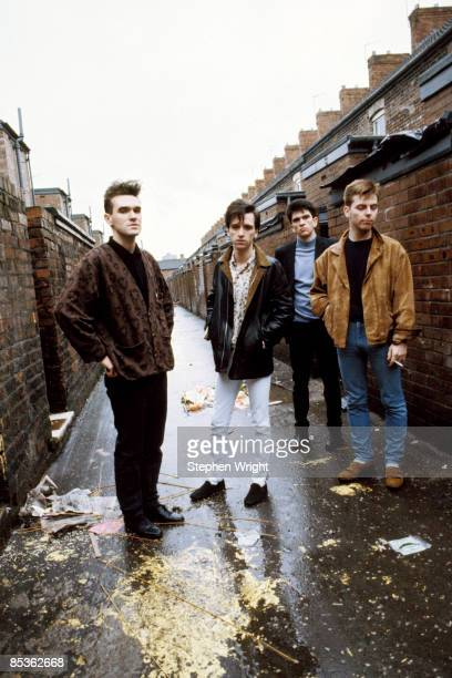 Photo of Andy ROURKE and Johnny MARR and Mike JOYCE and MORRISSEY and The Smiths LR Morrissey Johnny Marr Mike Joyce Andy Rourke posed group shot in...
