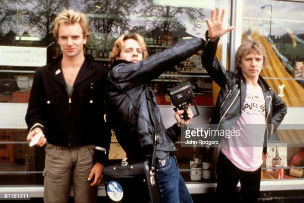 Photo of Andy SUMMERS and POLICE and Stewart COPELAND and STING LR Sting Stewart Copeland Andy Summers posed group shot