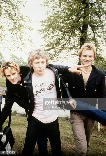 Photo of Andy SUMMERS and POLICE and Stewart COPELAND and STING LR Stewart Copeland Andy Summers Sting posed group shot