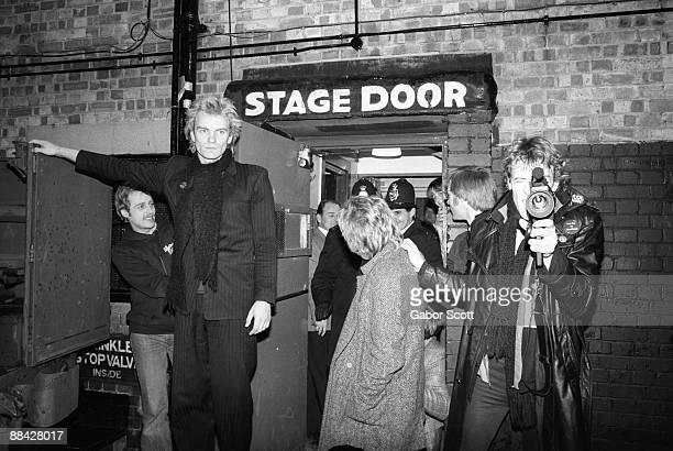 ODEON Photo of Andy SUMMERS and POLICE and STING and Stewart COPELAND LR Sting Andy Summers Stewart Copeland posed outside stage door on night when...
