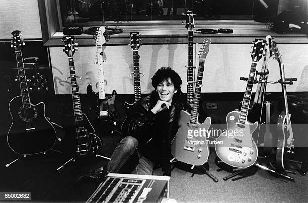 Photo of Andy TAYLOR and DURAN DURAN Andy Taylor posed with guitar collection in Maison Rouge studio during recording of 'Wild Boys'