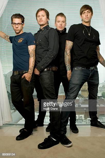 Photo of ANGELS AIRWAVES Posed group portrait Adam 'Atom' Willard Tom DeLonge Matt Wachter and David Kennedy