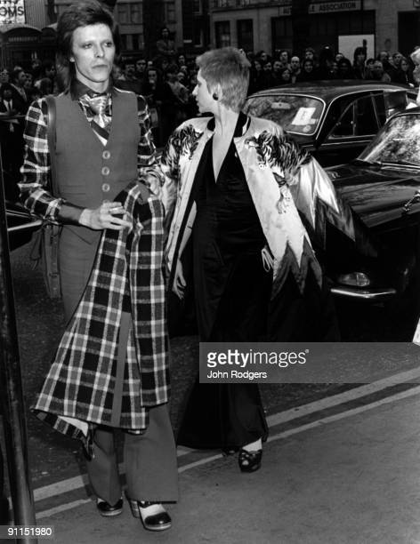 Photo of Angie BOWIE and David BOWIE; David and Angie Bowie arrive at the Empire, Leicester Square for the premier of 'Hitler's last ten days'
