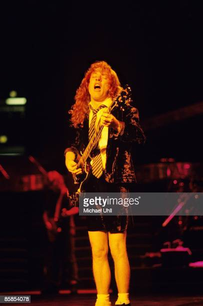 GARDEN Photo of Angus YOUNG and AC/DC Angus Young performing on stage