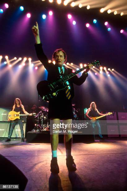 CLUB Photo of Angus YOUNG and Cliff WILLIAMS and Malcolm YOUNG and AC/DC and AC DC Malcolm Young Angus Young and Cliff Williams performing live...
