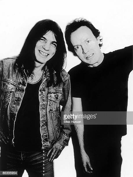 Photo of Angus YOUNG and Malcolm YOUNG and AC/DC Posed studio portrait of Malcolm and Angus Young