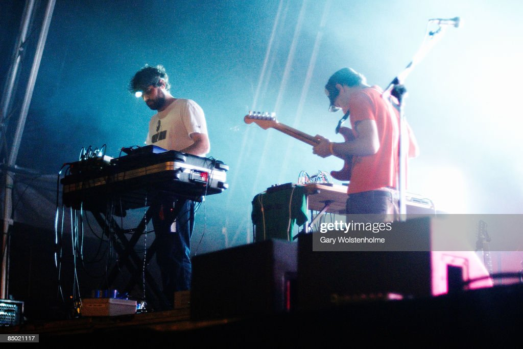 SOUND Photo of ANIMAL COLLECTIVE, Geologist (Brian Weitz) (L) performing on stage