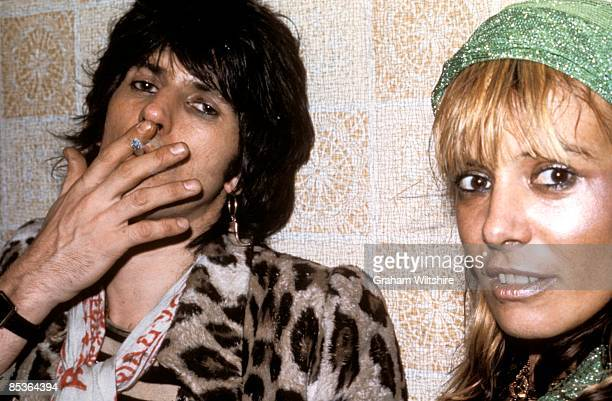 Photo of Anita PALLENBERG and Keith RICHARDS posed backstage w/ Anita Pallenberg