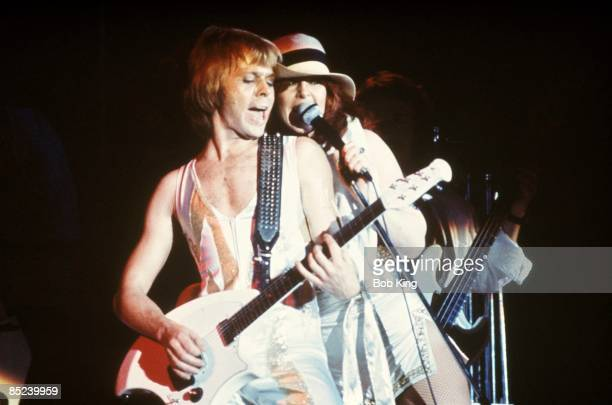 Photo of AnniFrid LYNGSTAD and Bjorn ULVAEUS and ABBA Bjorn Ulvaeus AnniFrid Lyngstad performing live onstage playing Ovation Breadwinner guitar