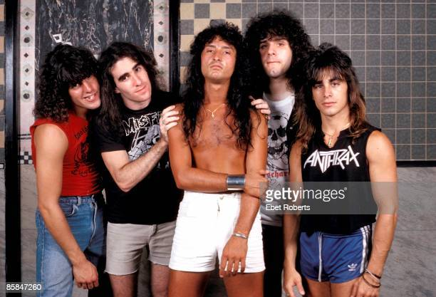 Photo of ANTHRAX Joey Belladonna is in the middle