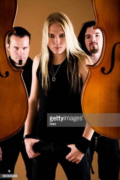 Photo of APOCALYPTICA Posed group portrait LR Paavo Lotjonen Eicca Toppinen and Perttu Kivilaakso at the Blank Studios Camden