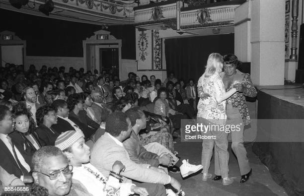 THEATER Photo of APOLLO THEATRE and James BROWN dancing with a fan showing audience and interior at Apollo Theater