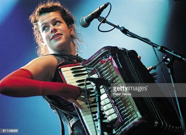 Photo of ARCADE FIRE, Arcade Fire, Nederland, Lowlands,, Biddinghuizen, 20 augustus 2005, Pop, indie, de accordeoniste speelt tegen een achtergrond...