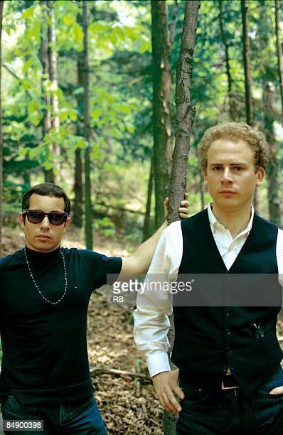 Photo of Art GARFUNKEL and Paul SIMON and SIMON GARFUNKEL and SIMON AND GARFUNKEL Posed portrait of Paul Simon and Art Garfunkel in the woods