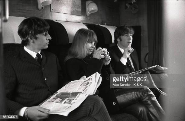 Photo of Astrid KIRCHHERR and BEATLES and Ringo STARR and John LENNON Ringo Starr Astrid Kirchherr John Lennon sitting on train during the filming of...