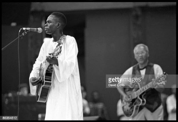 PARK Photo of Baaba MAAL and Ernest RANGLIN performing live onstage with Ernest Ranglin behind