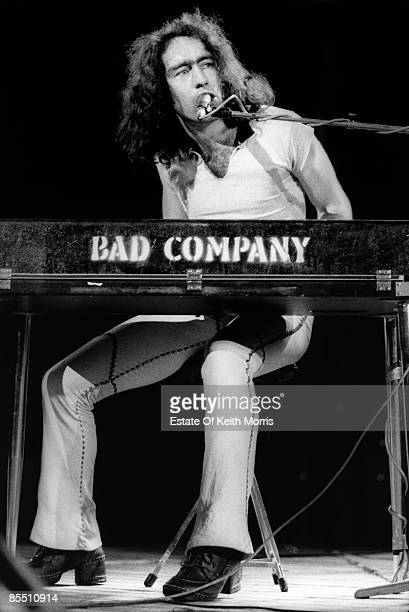 Photo of BAD COMPANY and Paul RODGERS Paul Rodgers performing on stage playing keyboards