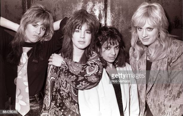 Photo of Bangles Posed group shot in dressing room L R Vicki Peterson Michael Steele Susanna Hoffs Debbi Peterson