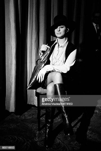 HOTEL Photo of Barbra STREISAND Posed portrait of Barbra Streisand full length sitting