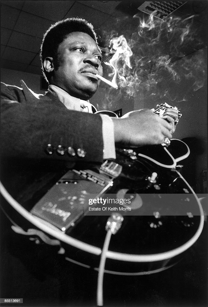 STUDIOS Photo of BB KING playing the guitar in the recording studio, smoking