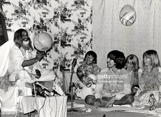Photo of BEATLES and MAHARISHI MAHESH YOGI and Ringo STARR and George HARRISON LR Maharishi Mahesh Yogi George Harrison Ringo Starr at a party to...