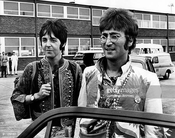 Photo of BEATLES and Paul McCARTNEY and John LENNON John Lennon Paul McCartney returning to Heathrow Airport from holiday in Greece