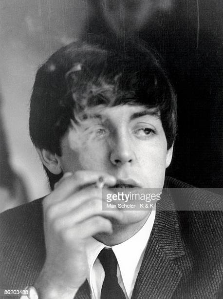 Photo of BEATLES and Paul McCARTNEY posed smoking cigarette during filming of 'A Hard Day's Night'