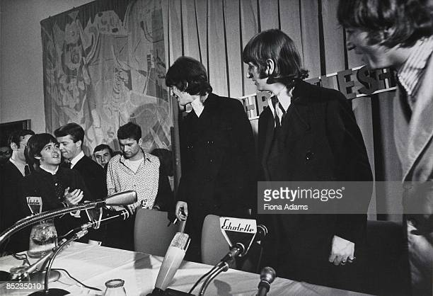 Photo of BEATLES George Harrison Ringo Starr and John Lennon at press conference on final German tour