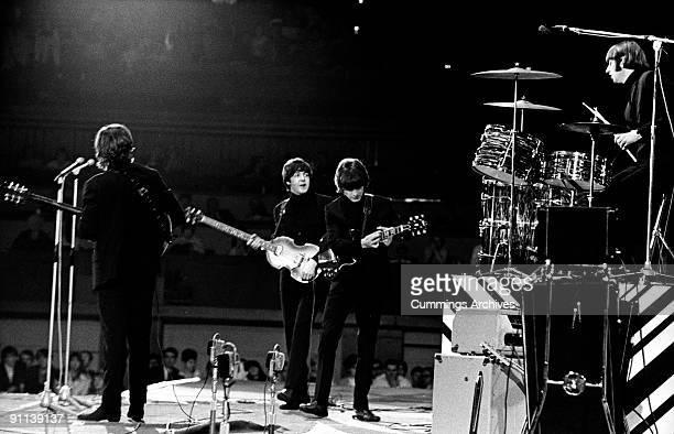 POOL Photo of BEATLES LR John Lennon Paul McCartney George Harrison Ringo Starr performing live onstage at NME Poll Winners concert