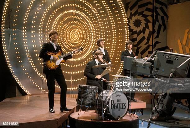Photo of BEATLES, L-R. John Lennon, Ringo Starr, Paul McCartney, George Harrison performing on show