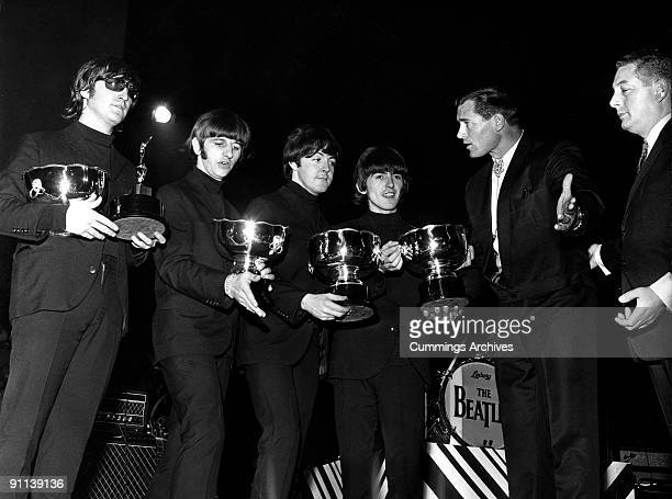 POOL Photo of BEATLES LR John Lennon Ringo Starr Paul McCartney George Harrison appearing at NME Poll Winners concert receiving their awards from...