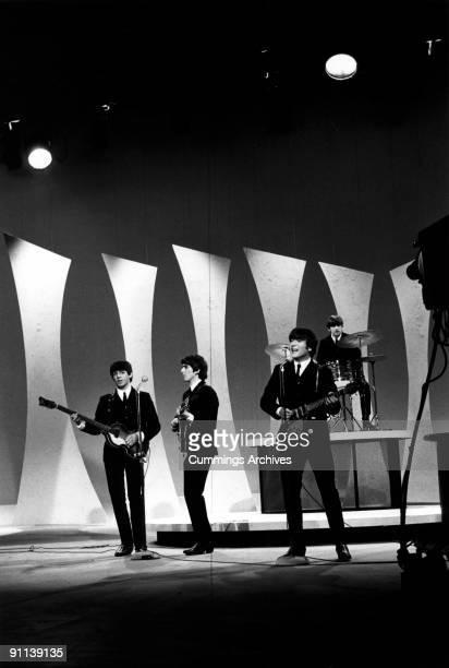 SHOW Photo of BEATLES LR Paul McCartney George Harrison John Lennon Ringo Starr performing on show on first US tour