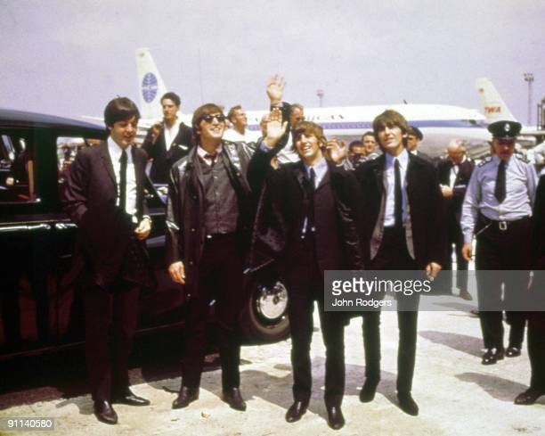 Photo of BEATLES Paul McCartney John Lennon Ringo Starr George Harrison posed group shot waving arriving at JFK airport