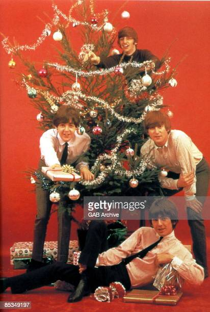 Photo of BEATLES The Beatles at Christmas clockwise from left Paul McCartney Ringo Starr John Lennon and George Harrison