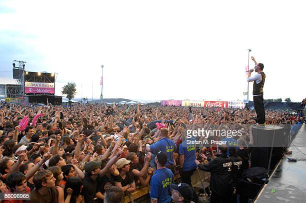 Photo of BEATSTEAKS, performing live onstage, with festival crowds behind, concerst, festivals, crowds, security