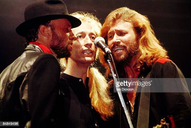 Photo of BEE GEES; L-R: Maurice Gibb, Robin Gibb, Barry Gibb performning live on stage.