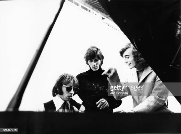 Photo of BEE GEES posed at a piano in Denmark in 1968 Left to right Maurice Gibb Barry Gibb and Robin Gibb