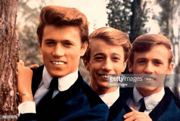 Photo of BEE GEES posed in 1964 Left to right Barry Gibb Robin Gibb and Maurice Gibb