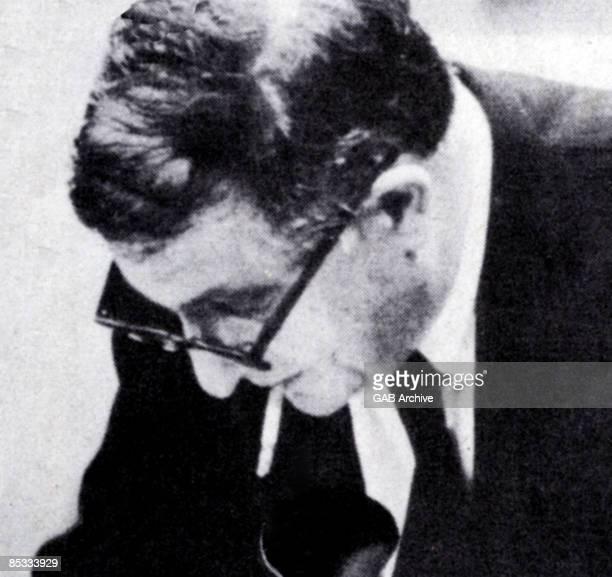 Photo of Bernard HERMANN posed smoking cigarette
