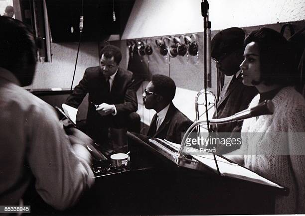 Photo of Berry GORDY and Barbara McNAIR In the Motown recording studio Berry Gordy second from left and Barbara McNair right