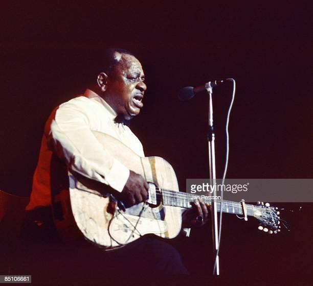 Photo of Big Joe WILLIAMS Blues guitarist Big Joe Williams performing on stage