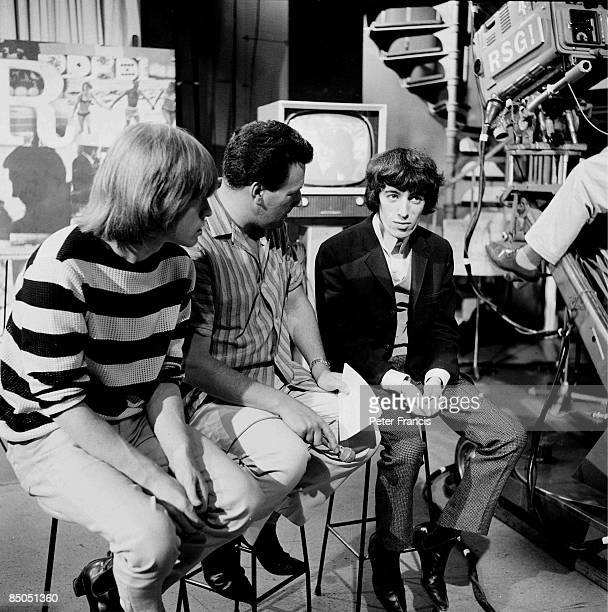 Photo of Bill WYMAN and Keith FORDYCE and ROLLING STONES, L-R: Brian Jones, Keith Fordyce , Bill Wyman being interviewed on the set of Ready Steady...