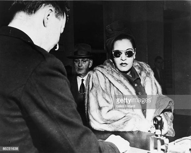 Photo of Billie HOLIDAY arriving at preliminary court hearing