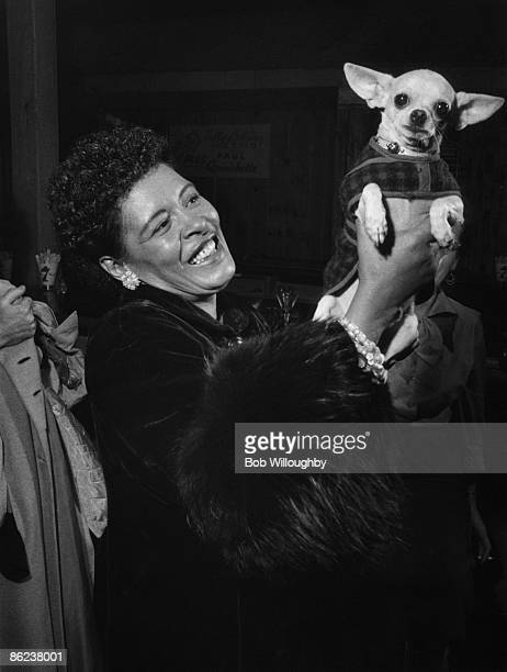 Photo of Billie HOLIDAY w/ her dog Peppi