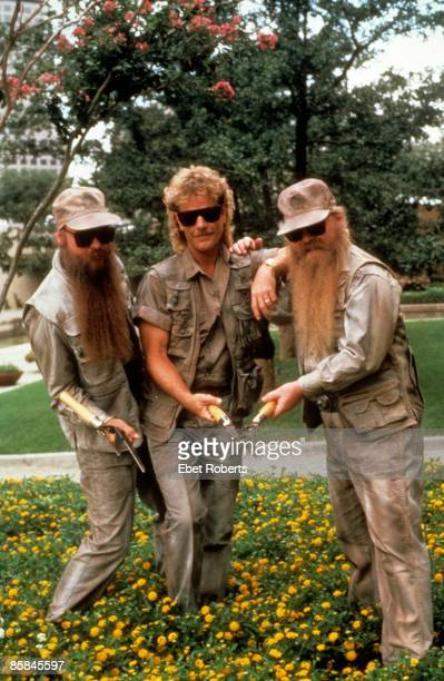 Photo of Billy GIBBONS and ZZ TOP and Frank BEARD and Dusty HILL LR Billy Gibbons Frank Beard Dusty Hill posed group shot with secateurs