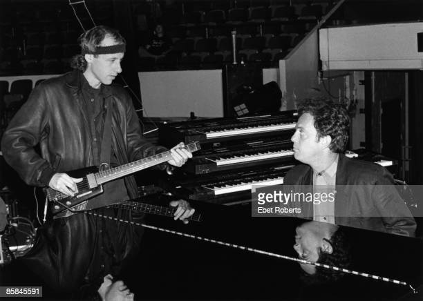 UNITED STATES OCTOBER 12 MADISON SQUARE GARDEN Photo of Billy JOEL and DIRE STRAITS and Mark KNOPFLER Mark Knopfler and Billy Joel performing on...